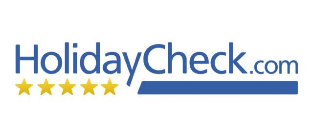 Logo des Reiseportals HolidayCheck.com.